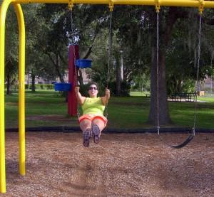 Liz having fun on the swings.