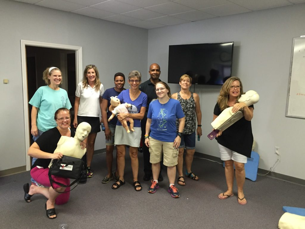 Group Leaders pose for a pic after CPR class with the instructor.